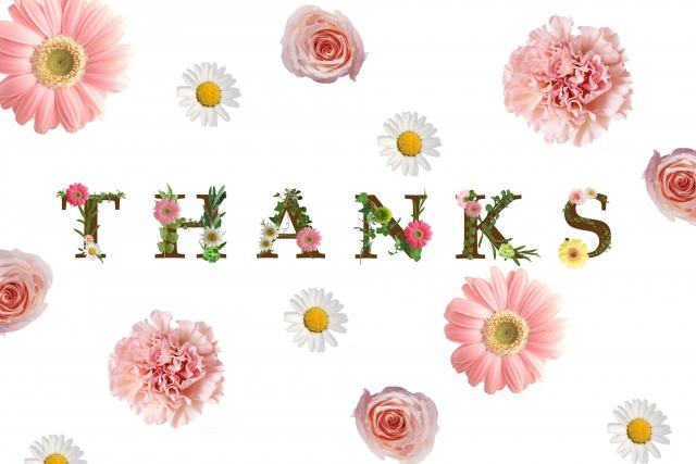 お花で感謝の言葉を作ったメッセージカードのような画像。情報にもバリアフリーを。障がい者とその関係者のコミュニティ、情報サイト。ナレバリ